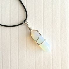 "Wire wrapped Opalite stone necklace. Black cord measures 17"", adjustable."