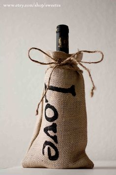 Would be easy to make. ($60.00 on etsy)   These burlap bags perfectly fit wine bottles, olive oil bottles, beer bombers and many other things! Wrapped with a simple twine ribbon, these make for beautiful gifts, centerpieces or wedding favors (for my fall wedding we put apples in these). These bags are perfect packaging for gifts