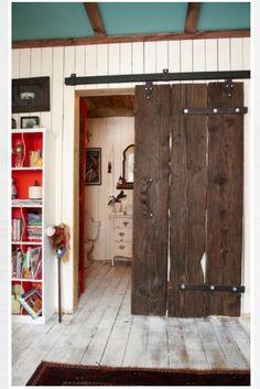 Save space with a sliding door instead of a swinging door... Plus old barn door looks cool