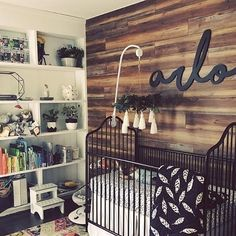 We see you ROYGBIV books! This rustic + warm nursery is so inviting!