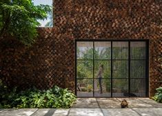Hole-punctured bricks bring air and sunlight into this multi-generational family home in the city of Bien Hoa, Vietnam designed by CTA Creative Architects.