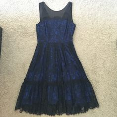 Black and blue dress Never worn! So pretty with black lace over dark blue. Has tulle on the inside near the knees. Knee length. Anthropologie Dresses