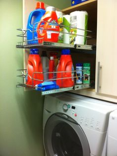 A Ikea base cabinet (with a pull out drawer system from Rev a shelf) mounted to the wall above the washer and dryer.