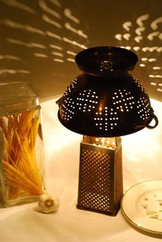 Use colander for a hanging light - (skip the grater) Spray paint shiny black