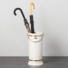 Always be ready to take on the elements — and keep your floors protected — with the Umbrella Stand from Hearth & Hand™ with Magnolia. This cream metal umbrella stand brings farmhouse-inspired style with the gold accents and handle. Just place it by your front door as an easy place to store your umbrellas. <br><br>Celebrate the everyday with Hearth & Hand — created exclusively for Target in collaboration with Magnolia, a home and lifes...