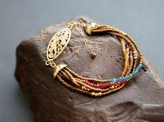 Beaded bracelet israeli jewelry. Gold blue red honey by Kvalwasser, $90.00
