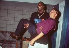 Shaquille O'neal holding billionaire Bill Gates in his Arms.