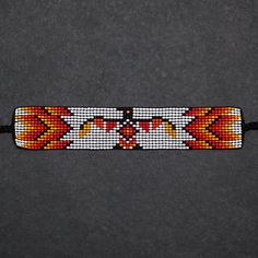 These beaded bracelets were designed and hand-loomed by shop member Charlotte Deavall. Charlotte is Anishinaabe from Winnipeg, Manitoba. She is from the Algonquin Ojibwe peoples. Learning from her Mom at a young age, she continues the tradition of loom beading. Inspired by her cultural