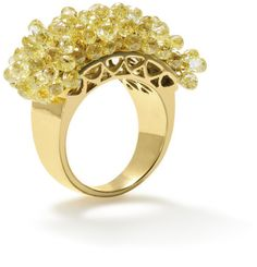 A coloured diamond ring  Designed as a wide half-hoop set with articulated briolette-cut coloured diamonds.