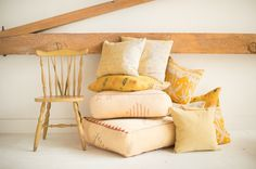 Found Vintage Rentals #yellow #chair #pillows #cushions #vintagerentals #eventdecor