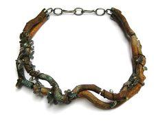 Blauwe Regen 2008. Necklace ø 20 cm. Wood, silver, labradorite, textile, pigment. Terhi Tolvanen . Collection Rotasa Foundation.