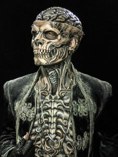 The prosthetics are the work of artist Akihito Ikeda. The model is actor Mick Ignis.