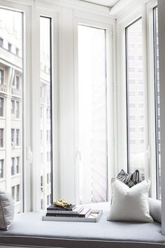 We're not leaving this corner window seat... ever.