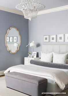 At Home in Arkansas - bedrooms - Gray room, tufted headboard, gray upholstered bench, white chandelier, gold mirror, white nightstand, Melissa