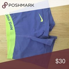 Nike pro shorts open to offers Nike pro shorts good condition worn a couple of times purple and green Nike Shorts