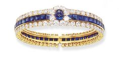A SAPPHIRE AND DIAMOND BRACELET, BY VAN CLEEF & ARPELS   Designed as a calibré-cut sapphire and circular-cut diamond hinged band with a central cabochon sapphire and circular-cut diamond cluster surround, 5.5 cm., with French assay marks for gold  Signed Van Cleef & Arpels, no. 25260