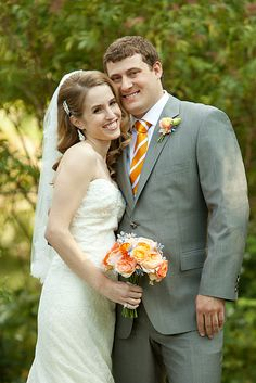 Leslie and her groom showing off their stunning wedding color palette