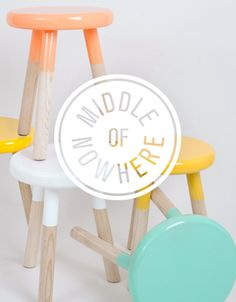Cute pastel paint dipped wood stools by Middle of Nowhere  identity by Mildred & Duck