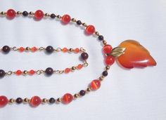 Red/orange cat's eye glass and ruby brecciated jasper necklace with red agate leaf focal by ParkhillDesigns on Etsy