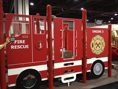 Barney Bear took a ride on this Fire Engine Playground by Burke, premier play environments while at NAEYC. Check out their amazing playgrounds!