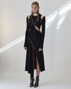 A black asymmetric slashed and pieced rib-knit dress, worn with caged ankle boots with hammered metal studs and toecaps by Alexander McQueen! Couture Fashion, Runway Fashion, Street Fashion, Womens Fashion, Paris Fashion, Knit Fashion, Look Fashion, Fashion Outfits, Fashion Design