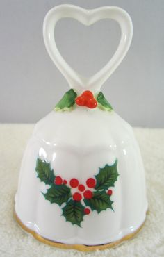 Vintage Christmas Bell - Bone China delicately hand painted with green holly leaves & red berries. Dated 1978 ENESCO, heart shaped handle.