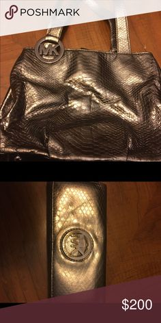 Authentic Michael Kors bag AND matching wallet! Authentic Michael Kors silver bag INCLUDES matching wallet! Gently used smoke free pet free home! Michael Kors Bags Shoulder Bags