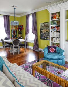 This home makes me smile. Fun colors, it's beautiful. Emily & Andrew's Colorful New Orleans Home #livingroom #diningroom #home #green #colors #purple #fun