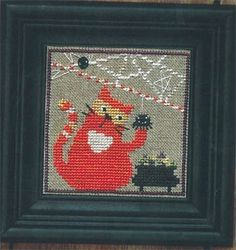 Snapper-Candy Corn Cat by Bent Creek. Orange/red cat checking out the Halloween candy under a spiderweb.  - I found this while browsing JuliesXstitch.com