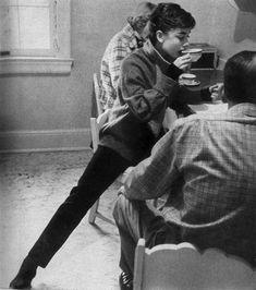 Audrey Hepburn grabbing a cup of tea, c. 1953