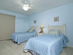 Guest bedroom includes 2 twin beds and TV/DVD combo, slider to balcony