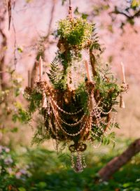 "Faerie Chandelier - lovely! Many wedding decor ideas, styles at the link. This is from ""natural wedding"" : made with sprigs of greenery, but should be able to combine a recycled chandelier with live plants."