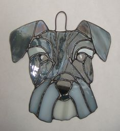 Stained glass Schnauzer face by GracefulGlassUK on Etsy https://www.etsy.com/uk/listing/587714426/stained-glass-schnauzer-face