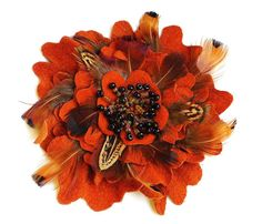 Orange red leatfer brooch with feather