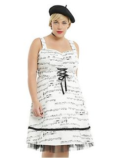 "<p>Music makes the world go 'round. We're pretty sure this music note dress will have you spinning in circles, too! White fit and flare dress has an allover music staff print that has us singing. The gathered sweetheart neckline, princess seams and faux corset waist detail helps add to your perfect silhouette. A black lace ribbon 3"" from the hem and a black tulle underlay are the final swing dress details that make us swoon! Back zipper closure.  </p>  <ul> 	<li style=""LIST-STYLE-POSITI..."