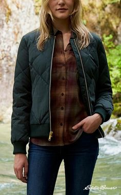 An Eddie Bauer Original. This new interpretation of The Women's 1936 Original Skyliner Jacket: Eddie's groundbreaking innovation—the first down jacket patented in America—gives it a modern fit while retaining the traditional bomber styling and signature diamond quilting that holds the down in place. Rib-knit collar, cuffs and hem.