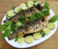 Don't let this whole fish intimidate you! Cooking whole fish is akin to cooking poultry or meat on the bone- more flavor and no more dried out fish.