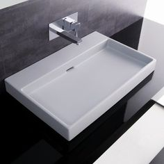 This ultra contemporary sink from WS Bath Collections can be mounted atop a counter or hung from the wall. It's rectangular shape and shallow basin will keep things very modern and streamlined in the bathroom.
