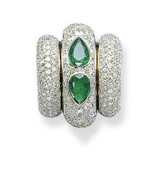 AN ART DECO EMERALD AND DIAMOND 'PONT' CLIP BROOCH, BY RENÉ BOIVIN  Designed as three single and circular-cut diamond arches, the centre accented by two collet-set pear-shaped emeralds, circa 1930, 3.5 cm long, with French assay mark for gold With maker's mark for René Boivin