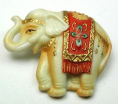 """Vintage Arita Porcelain Button Elephant Realistic w/ Trunk Up & Rug 13/16""""   Beautiful vintage Arita (Toshikane) porcelain button. Lovely elephant realistic. Trunk up and with colorful rug also. Circa 1940-50s  Very good condition.  Measures 13/16 inch.  SOLD $119.06"""