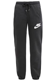 best service 12a9d 8bf8f Nike Sportswear RALLY - Tracksuit bottoms - noir blanc for with free  delivery at Zalando