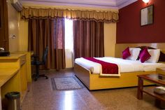 OYO Rooms #KalighatTemple Behind Lake Mall, #Kolkata Rainbow Wall, Kolkata, Style Inspiration, Bed, Hotels, Rooms, Furniture, Mall, Home Decor