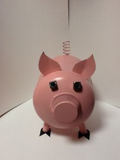 Perky Pig (14 1/2 in H, 9 1/2 W, 15 1/2 L)    $65.00     Made from AC tank, sheet metal, paper clip bin, bicycle tubing, spring from a car, bolts and marbles.