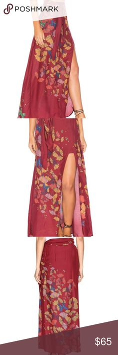 FREE PEOPLE BRI BRI BUTTERFLY MAXI SKIRT  SZ 8 Super soft and lightweight maxi skirt featuring a floral and butterfly print. Side slit detailing and an adjustable waist belt. Lined with a half-slip. Care/Import Machine Wash Cold Import Free People Skirts Maxi