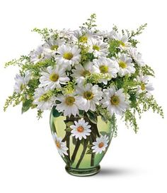 Daisies Daisies Daisies, even the vase.. love the vase!