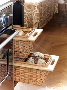 Basket drawers for produce and bread keep counters clear in a kitchen. Design: Nicole Hough