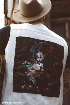 A denim jacket featuring a satin floral print patch on the back f26e4f4a5ab7