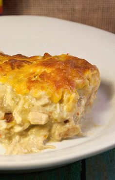 Must try dinner casserole! Stuffed with cheese, chicken and enchilada sauce!