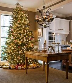 We love that this Christmas tree is in the midst of it all! - Traditional Home ®