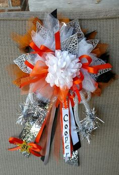 Mini homecoming mum; grandma mum; orange, black, & white mum